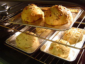 Rounds of soda bread in various stages of baking.