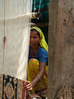A member of an SHG who used her loan to buy ca...