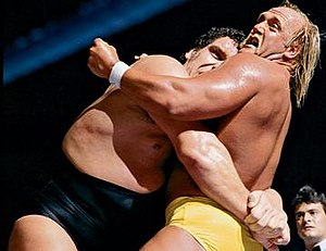 Andre the Giant applying a bear hug to Hulk Ho...