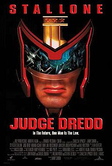 A Headshot Picture Of Judge Dredd Wearing His Helmet And With A View Of Mega