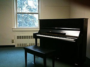 Practice room with upright piano.