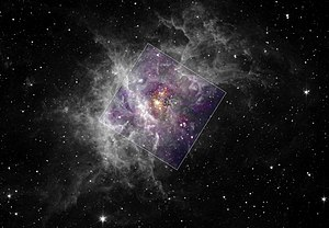 English: Westerlund 2 surrounded by stellar nu...