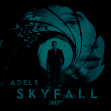 """A green-tinted image of the James Bond gun barrel. Adele's face is stamped in the barrel, and Daniel Craig's Bond is coming out of the barrel towards the viewer. The text """"Adele"""", """"Skyfall"""" and the """"007"""" logo are seen at the bottom of the image."""