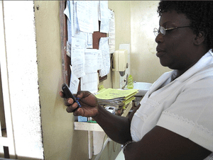 Medical nurse uses a mobile phone in Accra, Ghana