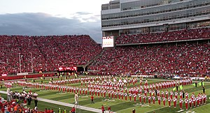 The Cornhusker Marching Band performing a half...