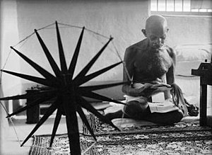 An iconic photograph of Gandhi at a spinning w...
