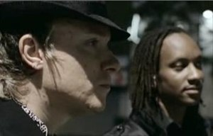 Liam Howlett and Maxim in the music video