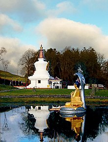 a ginormous muckle stupa in bonny Scotland with a wee Buddha in front