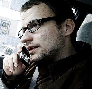 John Longanecker talking on a phone after eati...