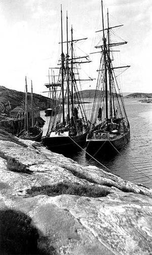 sailing ships tied to shore, circa 1900-1920