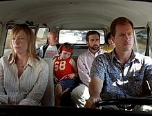 A Film Screenshot Shows The Family All Seated In The Volkswagen Microbus As It Is Driven