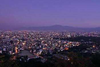 The city of Kathmandu at dusk on the night of ...