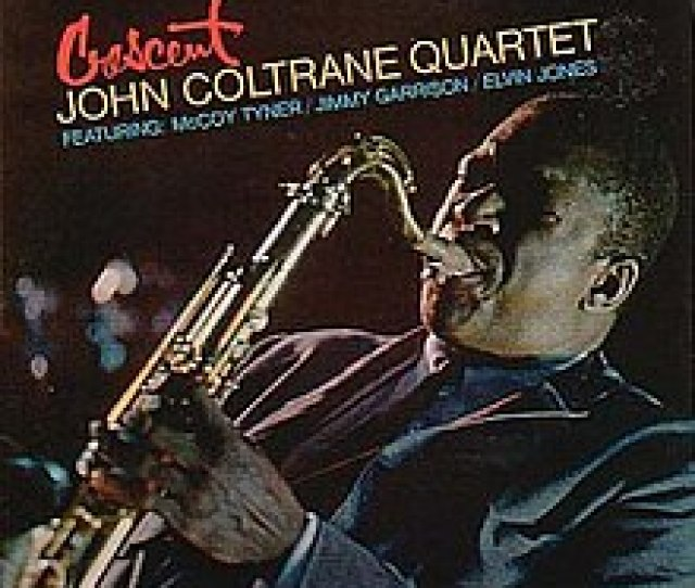 A Slanted Photograph Of Coltrane Playing Saxophone In A Blue Suit Facing The Left The Studio Album By