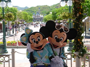 Mickey and Minnie in summer outfits, with Main...