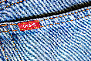 The denim fabric of a jeans
