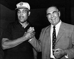 Joe Louis (left) poses with Max Schmeling