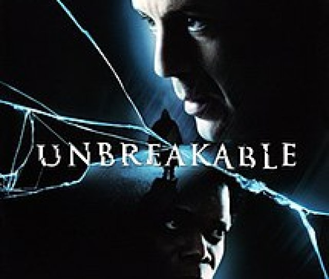 Unbreakable Movie Poster Showing The Head Of A Man On The Top Right Looking To The Left