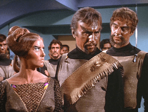 Two Klingon males and a female as they appear ...
