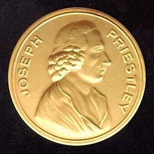 "Photograph of a gold medal, which says ""Joseph Priestley"" around the edge and has a profile of a man stamped in the center"