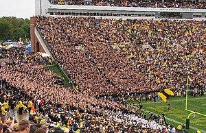 "Iowa fans make an ""I"" with their arm..."