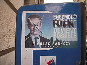 A pro-Sarkozy sticker, after being defaced, in...