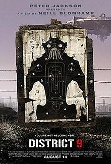On dirty dusty ground, a black and white target practice poster of a bipedal insect-like creature stands, riddled with bullet holes. Barbed wire runs behind the poster and a large circular spaceship hovers in the background.