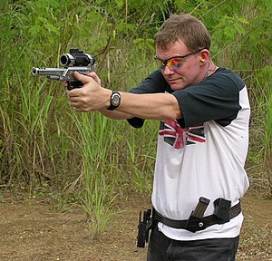 An IPSC shooter using a modified .38 Super pis...