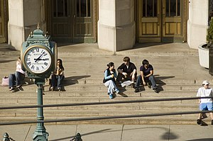 Students take a break on the steps of the Coll...