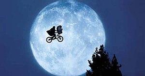 E.T. makes Elliott's bike fly to the forest.