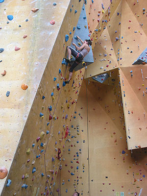 "A lead climber ""clipping in"" to a qu..."