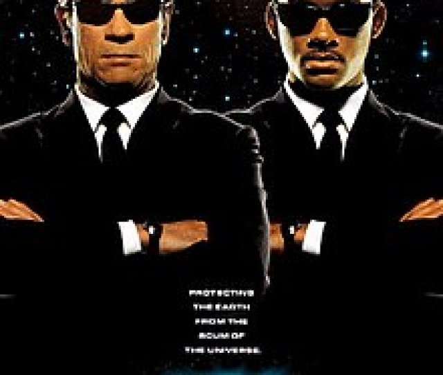 Men In Black Two Gentlemen Both Wearing Suits And Sunglasses A Caucasian And An African American