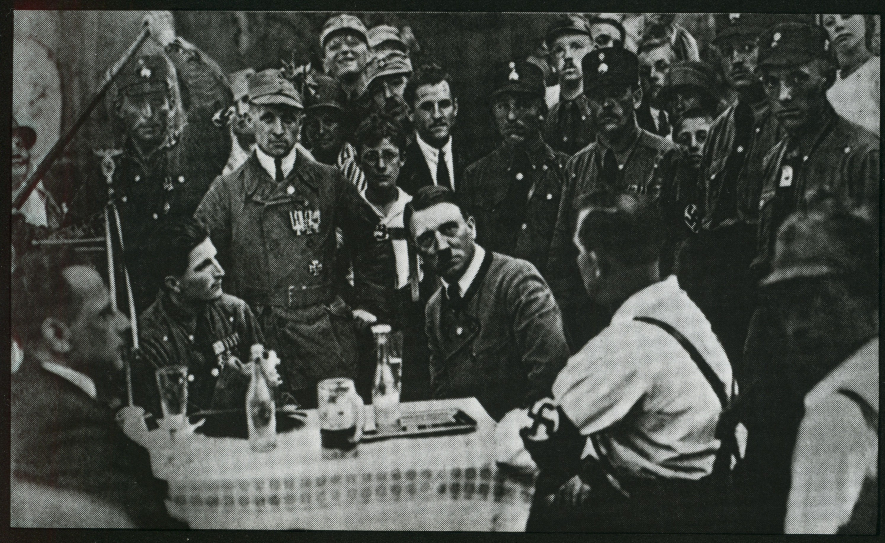 Meeting of the members of the NSDAP in Munich. In the center sits Adolf Hitler.