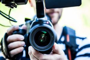 video production company man holding camera
