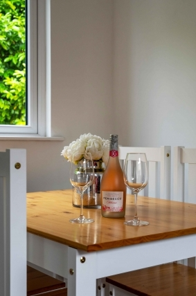 skyclad homes table with wine glasses and persecco photography production