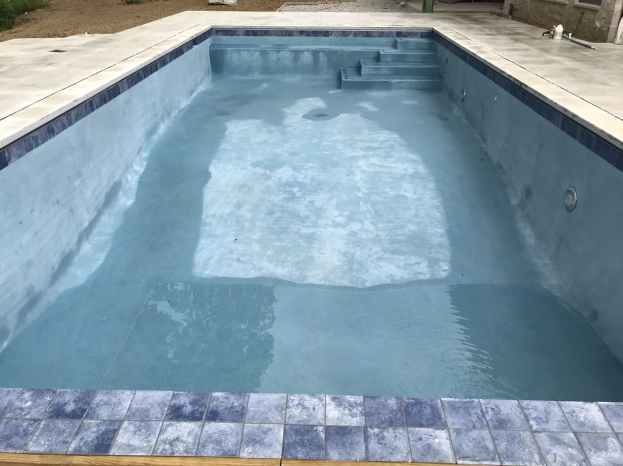 pool trim tile installation