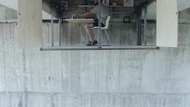 This Designer Built a Floating Studio Hidden Under a Bridge