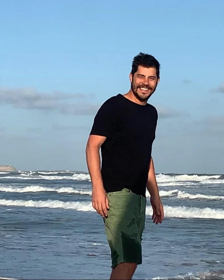 Evaristo Costa on the beach
