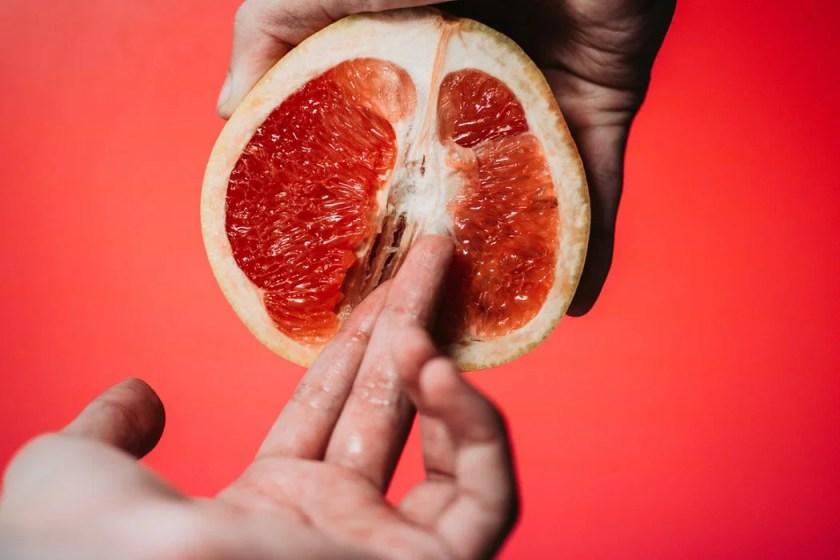 hand holding half an orange