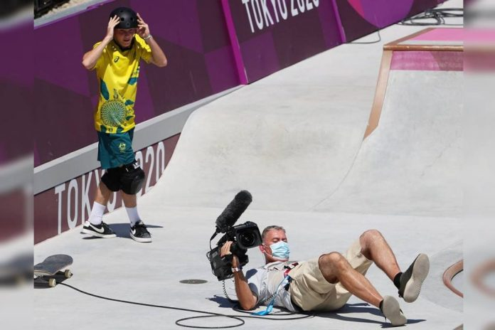 TOKYO, JAPAN - AUGUST 05: Kieran Woolley of Team Australia crashes into a TV Cameraman during the Men's Skateboarding Park Preliminary Heat 3 on day thirteen of the Tokyo 2020 Olympic Games at Ariake Urban Sports Park on August 05, 2021 in Tokyo, Japan. (Photo by Jamie Squire/Getty Images)