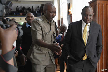 Kenya's Finance Minister Henry Rotich (R) arrives at the Milimani Law Courts in Nairobi on July 23, 2019, as he faces corruption charges.