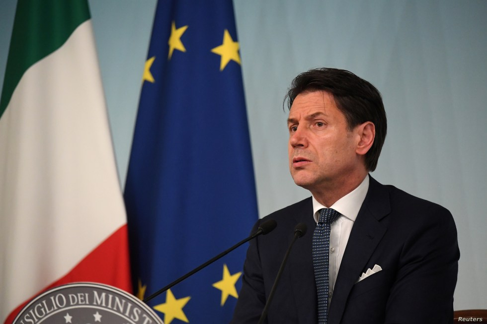 Italian Prime Minister Giuseppe Conte reacts to Italy's ruling coalition breakdown, speaking to journalists at an impromptu, late evening news conference in Rome, Aug. 8, 2019.