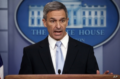 FILE - In this Aug. 12, 2019, file photo, acting director of U.S. Citizenship and Immigration Services Ken Cuccinelli speaks during a briefing at the White House in Washington. Cuccinelli is emerging as the public face of the president's hard-line…