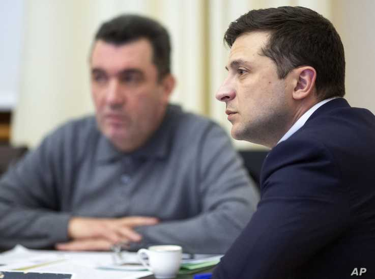 In this handout photo provided by the Ukrainian Presidential Press Office, Ukrainian President Volodymyr Zelenskiy leads a…