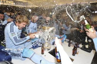 Sporting Kansas City celebrates heartily following their MLS Cup win. Photo courtesy of @SportingKC