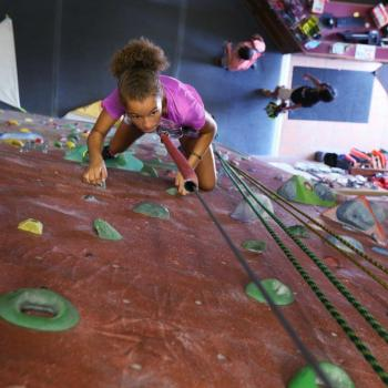 youth girl rock climbing at upper limits downtown st. louis best indoor rock climbing gym and fitness facility