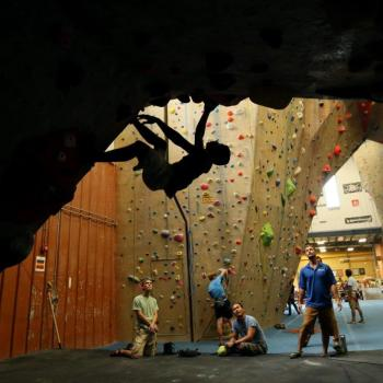 bouldering exercise at upper limits indoor rock climbing gym st. louis