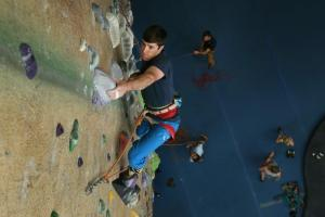 lead climbing male at upper limits indoor rock climbing gym st. louis