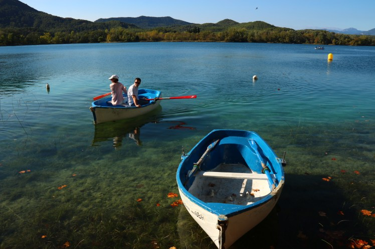 boats and people rowing on Lake Banyoles, Spain