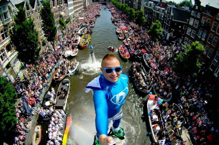 overcrowded with boats and people Canal Parade in Amsterdam