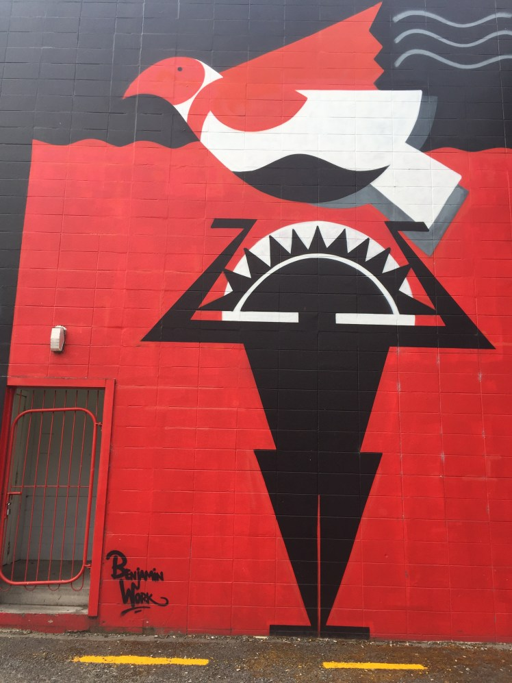 a sun god holding a dove, graffiato street art festival, Taupo